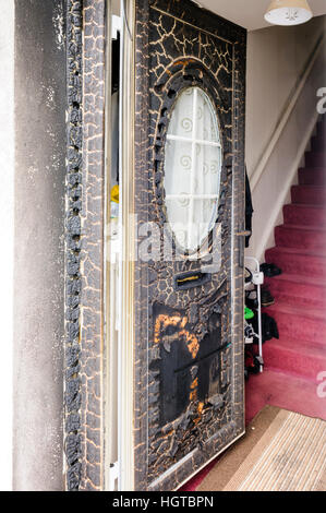 UPVC front door seriously damaged in a rascist arson attack. - Stock Image
