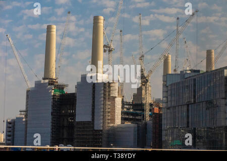 Battersea Power Station, covered in scaffolding during its redevelopment - Stock Image