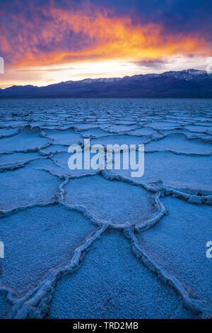 Polygonal salt pans and Panamint Range, Badwater Basin, Death Valley National Park, California USA - Stock Image