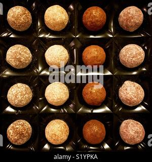 Chocolate truffles dusted with glitter and icing sugar - Stock Image