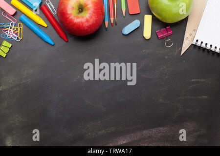 School education supplies on chalkboard backdrop. Back to school template concept. Top view flat lay with copy space for your text - Stock Image