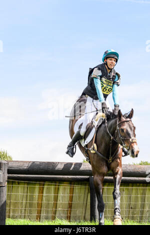 Rockingham Castle, Corby, UK. 21st May, 2017. Emma Stretton and her horse Willy Ever clear an obstacle on a sunny - Stock Image