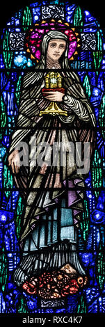 St. Clare of Assisi with the Blessed Sacrament in her hand, St. Oswald & St. Edmund Church, Ashton-in-Makerfield, Greater Manchester, UK - Stock Image