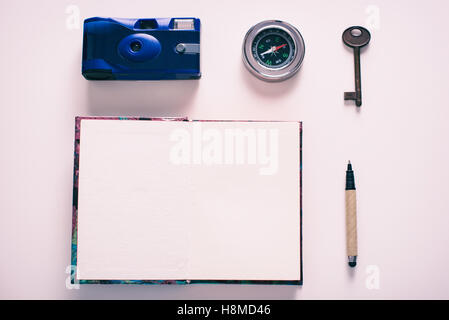 Accessories for travel. Camera, Compass, hey, pen, notebook - Stock Image