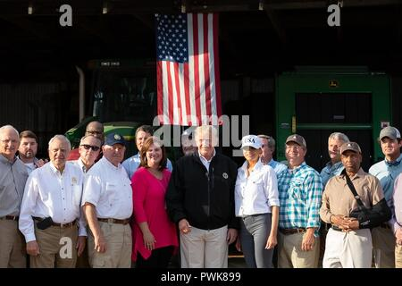 Panama City, Florida, USA. 15th Oct 2018. U.S President Donald Trump, First Lady Melania Trump and Agriculture Secretary Sonny Perdue left, meet with local farmers to discuss the impact of Hurricane Michael on crops at Charlie Stewarts Farm October 15, 2018 in Macon, Georgia. Credit: Planetpix/Alamy Live News - Stock Image