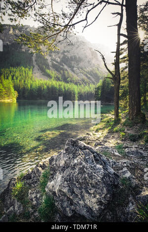 Green Lake in Styria with mountain in the background during summer , Austria - Stock Image