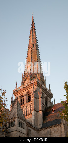 Gothic spire of Saint Nazaire Catholic Cathedral Autun Burgundy France in evening light - Stock Image