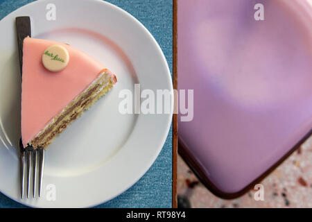 A slice of Torta Rosa and pastel furniture at Bar Luce, Wes Anderson-inspired bar and cafe in the Fondazione Prada district of Milan, Italy - Stock Image