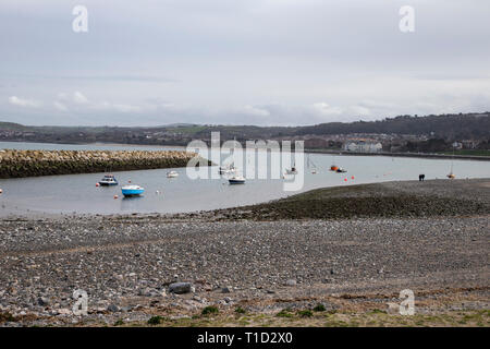 Boats and yachts at anchor in the small harbour inlet at Rhos on Sea, North Wales - Stock Image