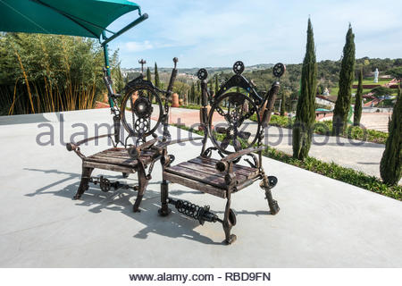 a pair of elaborate thrones made from recycled metals, Quinta dos Loridos, Bombarrel, Portugal - Stock Image