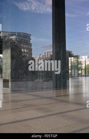 Neue Nationalgalerie in Berlin before renovation/restauration. Surrounding reflecting in windows. - Stock Image