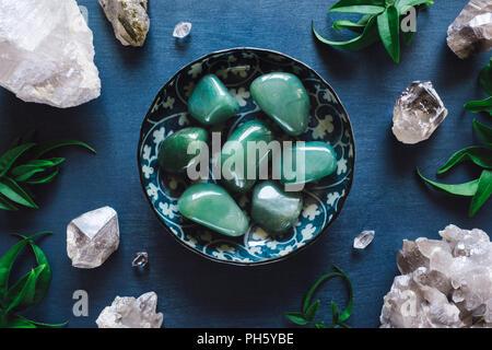 Green Aventurine and Quartz on Blue Table - Stock Image