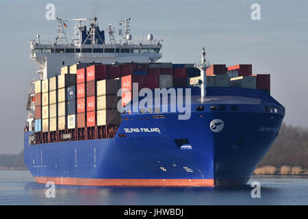 Kiel-Canal-Max containerfeeder Delphis Finland, maiden voyage in the Kiel Canal - Stock Image
