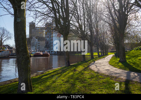 Leiden, Holland - March 24, 2019: Anker park with boats and the Meelfabriek building in the background - Stock Image