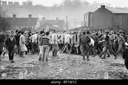 The traditional Royal Shrovetide Football Match, a 'medieval football' game played annually on Shrove Tuesday and Ash Wednesday in the town of Ashbourne in Derbyshire. Crowded scenes as the two day game is under way. 22nd February 1966. - Stock Image