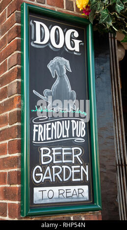 Chalkboard sign outside a public house indicating a dog friendly pub with beer garden Wallasey Village February 2019 - Stock Image