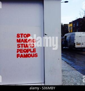 Stop Making Stupid People Famous, graffiti in Camden Town, London - Stock Image