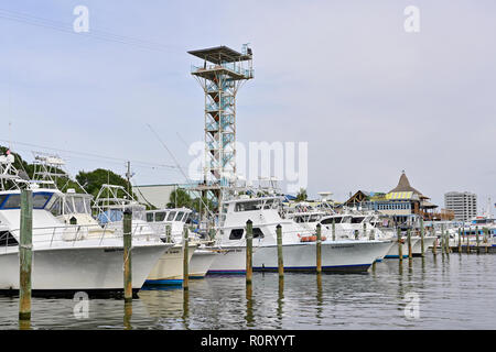 Part of the Destin commercial charter fishing fleet or boats along the Gulf coast in the Florida panhandle at Harbor Walk Marina, Destin Florida USA. - Stock Image