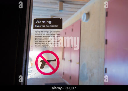 A warning sign on a glass door of the Ansel Adams Gallery in Yosemite Village, to not carry guns inside the premises - Stock Image