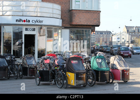 Nihola tricycles on sale front of a shop in Copenhagen. - Stock Image