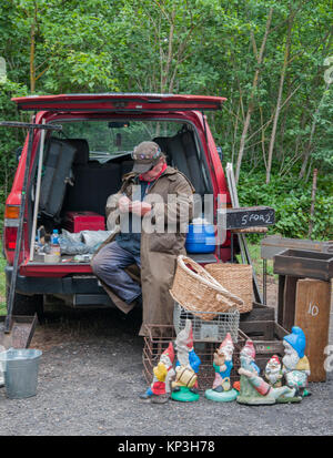 Stallholder with his gnome collection, at the Sunday country market in Daylesford in the Central Highlands goldfields - Stock Image