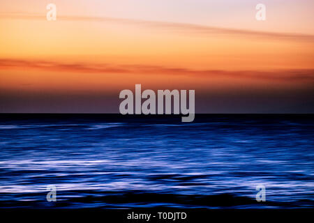 Water with stretch movement motion effect and coloured sky - sunset time with touristic and vacation concept - Stock Image