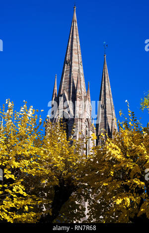Strasbourg, Alsace, France, spires of St Paul protestant church, Neustadt district, trees with autumn foliage, - Stock Image