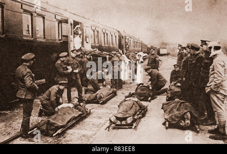 Wounded soldiers awaiting transportation back to the UK on a hospital train during the war on the Western Front of World War One. - Stock Image