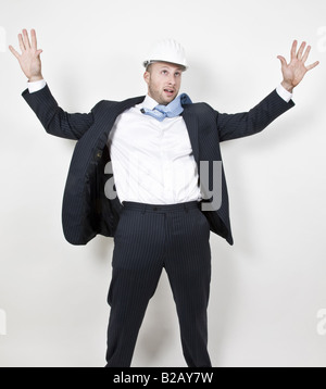man standing with hands outstretched - Stock Image
