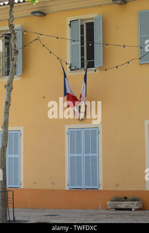 French Tricolor Flags On The Town Hall (La Mairie) Of Castellar In France, French riviera, Europe - Stock Image