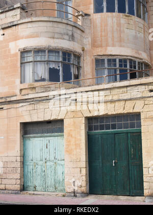 Room for improvement, a dilapidated building facade on the seafront promenade near Valetta in Malta - Stock Image