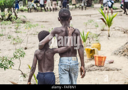 brotherly love in the Turtle Islands, Sierra Leone, West Africa. - Stock Image