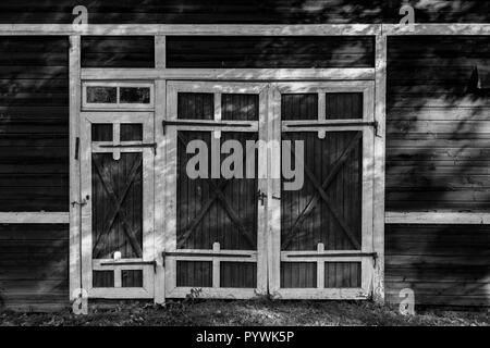 Barn door in an old Swedish farm in northern Sweden - Stock Image