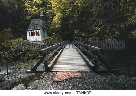 Beautiful scenery of a church in the national park st bartholomew with a bridge during spring - Stock Image