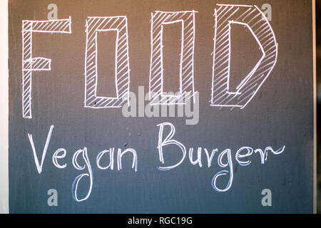 Vegan Burger text on the chalkboard, vegan bar sign - Stock Image