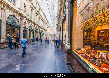 SHOP OF A CHOCOLATIER, DIFFERENT SHOPS, THE GALERIES ROYALES SAINT-HUBERT, A GLAZED SHOPPING ARCADE, CITY, BRUSSELS, - Stock Image