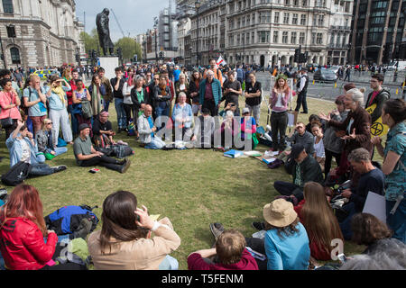 London, UK. 24th April 2019. Climate change activists from Extinction Rebellion gather in Parliament Square on the tenth day of the International Rebe - Stock Image