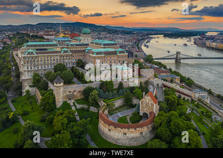 Budapest, Hungary - Aerial skyline view of Buda Castle Royal Palace with Matthias Church, Szechenyi Chain Bridge and Parliament building with a beauti - Stock Image