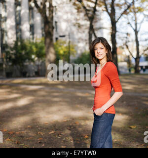 Young woman in park - Stock Image