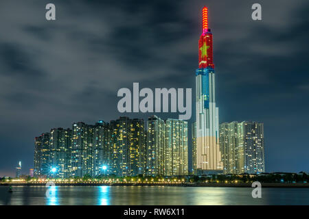 Colorful architectural landscape of night scene from skyscrapers along the river with many sparkling lights to welcome Lunar New Year 2019 - Stock Image