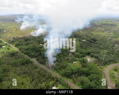 A pyroclastic lava flow from the Kilauea volcanic eruption moving toward a subdivision May 4, 2018 in Leilani Estates, Hawaii. The recent eruption continues destroying homes, forcing evacuations and spewing lava and poison gas on the Big Island of Hawaii. - Stock Image