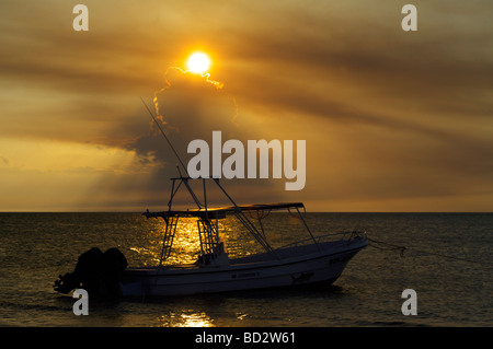 A magnificent sunset over Holbox Island, Quintana Roo, Yucatán Peninsula, Mexico, fishing boat - Stock Image