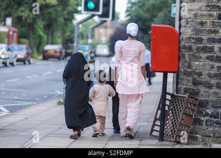 Group of muslim kids on the street - Stock Image