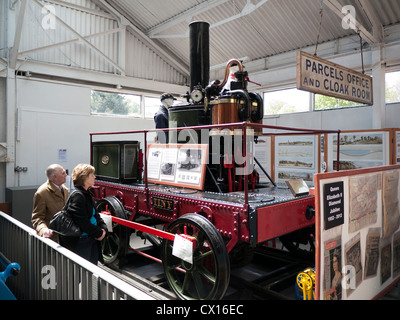 People looking at Tiny a Broad Gauge locomotive at the Railway museum in Buckfastleigh in Devon - Stock Image