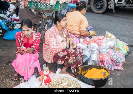 Mae Sot, Thailand - February 3rd 2019: Ethnic market vendors on the morning market. The market is open every day. - Stock Image
