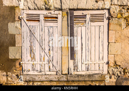 Cracked paintwork on window shutters. - Stock Image