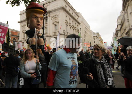The inventor of the giant Donald trump statue wears a ÒThe Man of StealÓ shirt During a protest which coincides with Donald TrumpÕs state visit to the United Kingdom on 04/06/2019 - Stock Image