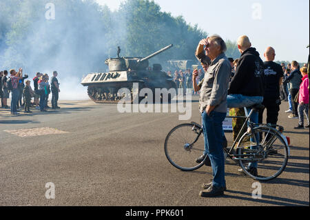 ENSCHEDE, THE NETHERLANDS - 01 SEPT, 2018: People watching tanks rolling by from the second world war during a military army show. - Stock Image