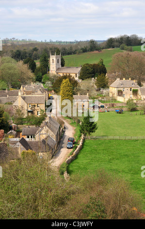 View of Naunton, Gloucestershire showing St Andrew's Church - Stock Image