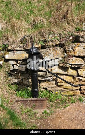 Old water pump, Naunton, Gloucestershire - Stock Image